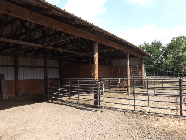 This is a picture of the barn and two stalls within the 1.5 acre pasture.