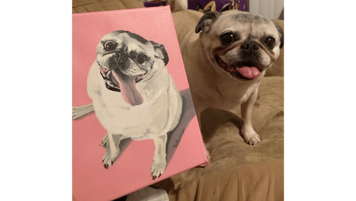 "Athena poses with her 8x10"" painting on canvas."