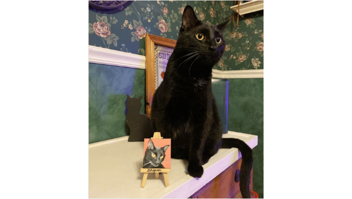 "Bhagwan at home, posing with his mini-portrait, 2.5"" sq. canvas with accompanying personalized easel.  This is an example of a $40 painting."